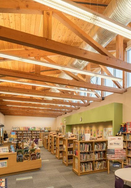 Interior of the Library with Timber Trusses in the Rippowam Cisqua School in NY.