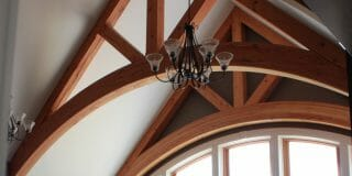 Arched Timber Trusses in the Interior of the Daignault residence in Adams, MA