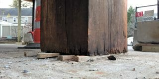Timber post set directly onto concrete.