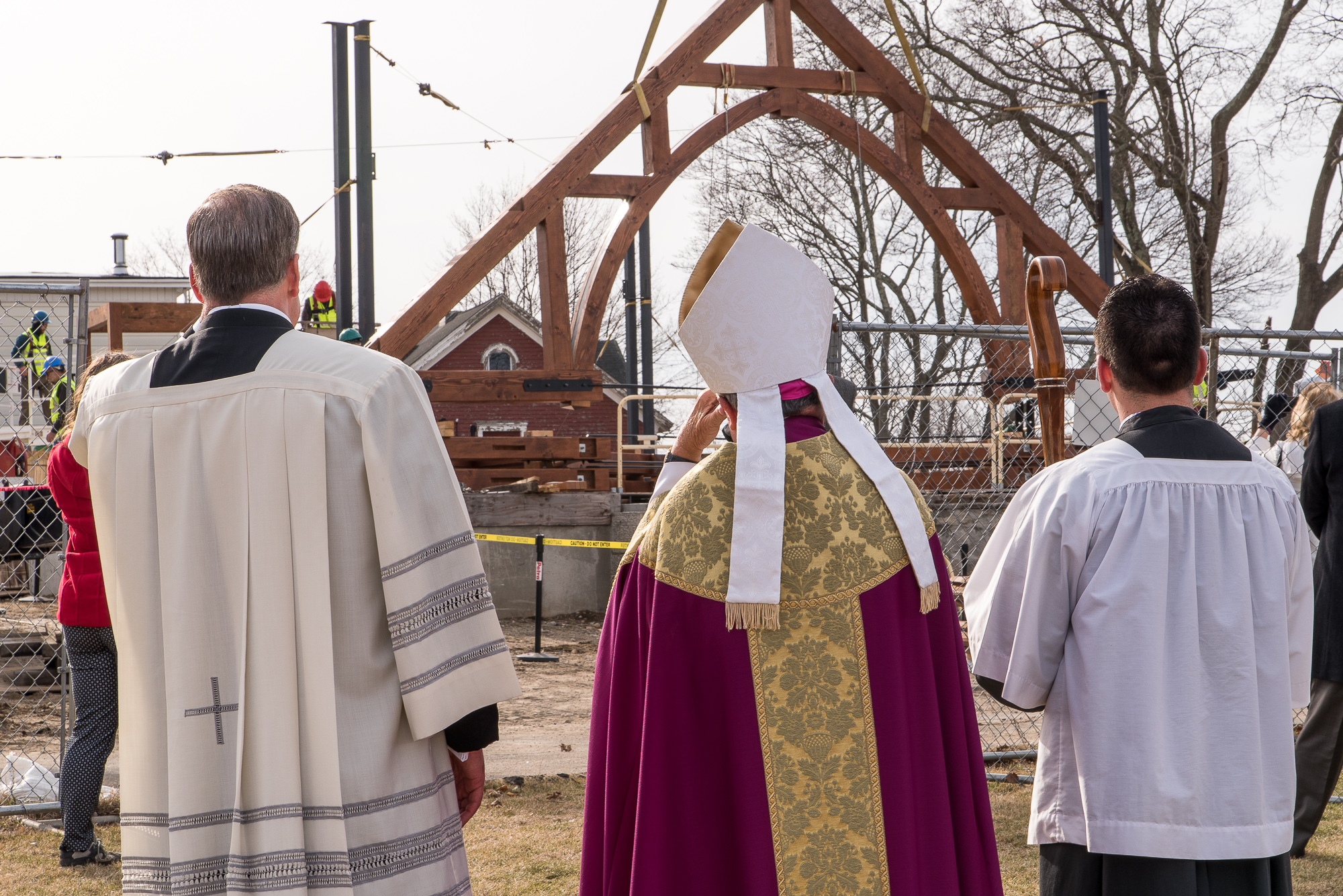 Raising the Trusses while the clergy looks on at the Church of St. Michael the Archangel