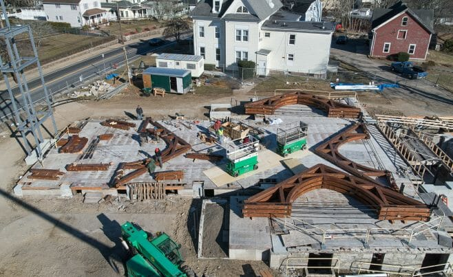 Arches laid out before being raised into place at The Church of St. Michael the Archangel