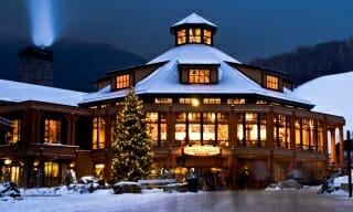 Octagon Timber Frame Ski Lodge at Night