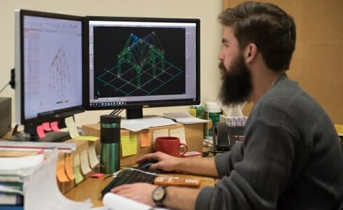Matt, Engineering working at his computer