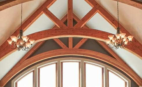 Arched Trusses in a timber frame home. Daignault Residence.