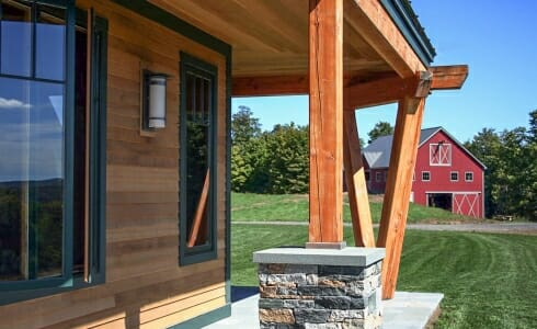Exterior beams with stone post bases on the porch of the Night Pasture Farm in Chelsea, VT