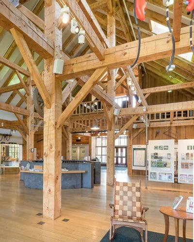Hand hewn post and beam timber frame barn interior in the Southern Vermont Welcome Center