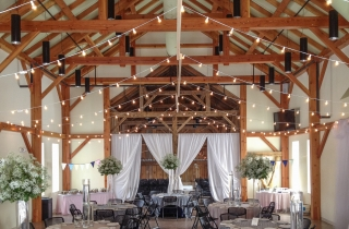 Dining Room in a Timber Frame Event Barn decorated for a wedding