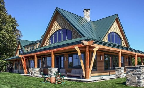 Exterior of the Night Pasture Farm with beams with stone post bases on the porch in Chelsea, VT