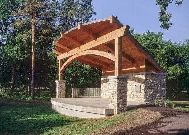 Outdoor Theater with Timber Posts, an Arched Beam and a Sturdy Timber Roof