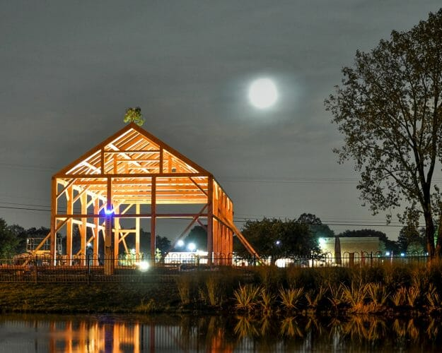 The completed Douglas Fir post and beam frame in the Moonlight