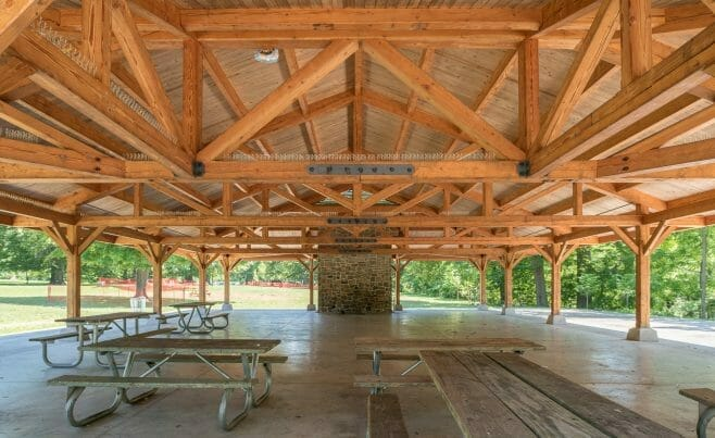 Timber Frame Trusses with steel connecting plates in an outdoor Picnic Shelter