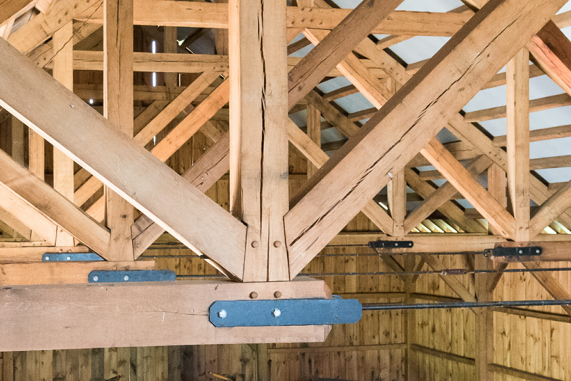 Oak Timber Frame with Steel Tie Rods in Traditional Rich Barn