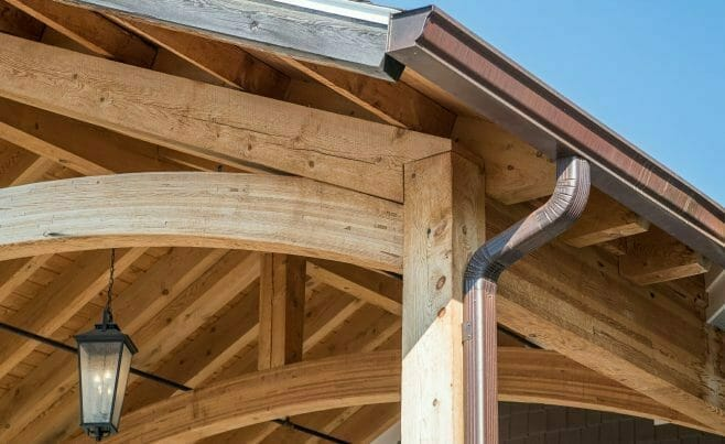 Heavy Timber Porte Cochere Entry Way at Lenny's Shoe Store with rough sawn hemlock and glulam arches