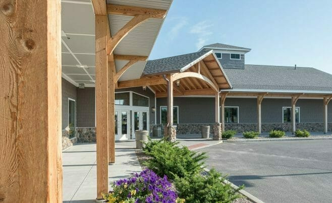 Heavy Timber Porte Cochere Entry Way and Timber Posts at Lenny's Shoe Store with rough sawn hemlock and glulam arches