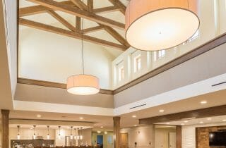 The King Post Trusses in the Christina Seix Academy in Trenton, NJ were made with Kiln-dried Douglas fir. The King Post Trusses highlight the cathedral ceiling and tall stone fireplace.