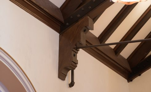 Decorative Corbel under truss with steel tie rod