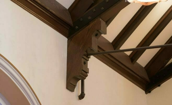 Decorative Corbel under truss with steel tie rod