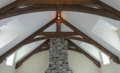 Decorative Corbels on Trusses above a stone fireplace