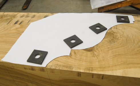 Preparing to cut decorative scrolls for a timber frame