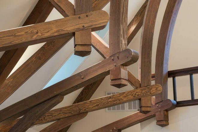 Finials on Dark Stained Timber Arches