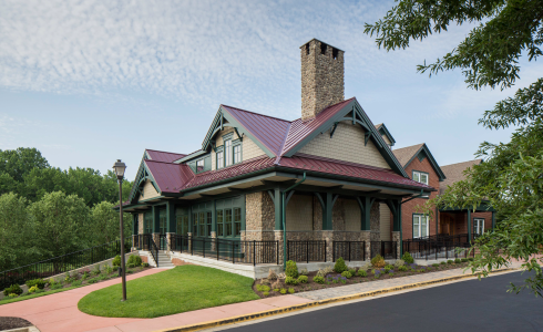 Douglas fir trusses in the Golf Club at South River featuring cathedral ceilings, a large open dining room, and a tall stone fireplace. The exterior of Golf Club at South River.