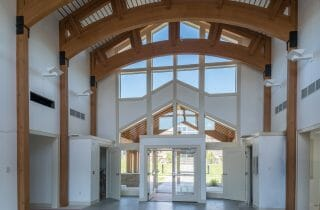 The Mahamudra Buddhist Retreat in Cragsmoor, NY has a heavy timber entry way and interior trusses fabricated from Glulam and Douglas Fir