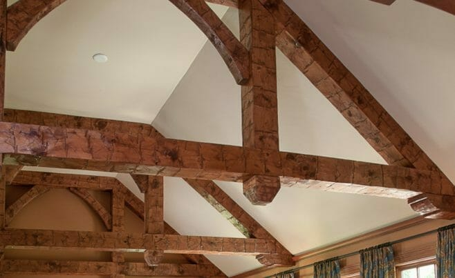 Hand Hewn Corbels and Finials on Trusses in a home