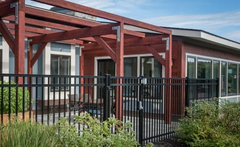 The Porch at Harmony Homes features Douglas fir Glulam posts and beams