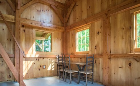 Posts and beams with traditional joinery and connections in the Ox Hill Barn in Vermont Fabricated from Glulam and Douglas Fir.