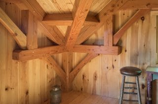Complex joinery and connection joining post and beams and trusses in the Ox Hill Barn fabricated from Glulam and Douglas Fir