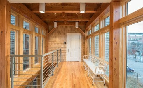 Lofted upstairs area with Large windows and Douglas fir beams in the Port Society Complex