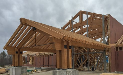 Rafter Scrolls on an assembled Timber Frame Porte Cochere Entry way