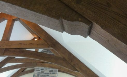 Dark Stained Timber Trusses with Scrolls