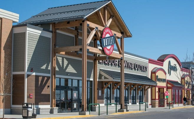 The Woodmont Liquor Store in Londonderry, NH has a Heavy Timber Entryway with black steel galvanized plates built by Vermont Timber Works.