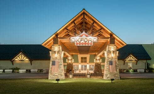 Heavy Timber Porte Cochere Entry Way at the Oxford Casino in Maine with King post trusses in White Pine with steel plates.