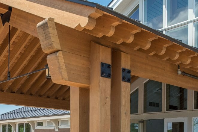 Timber Frame Scrolls on a Porte Cochere with steel plates and tie rods