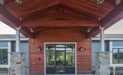 The Porte Cochere at Harmony Homes features Douglas fir Glulam Arches