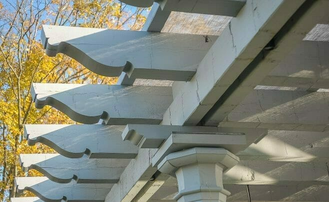 Whitewashed Scrolls on a Timber Frame Pergola