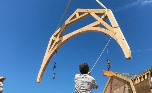 Positioning the reclaimed oak hammer beam truss in the Seven Gates Residence in Martha's Vineyard