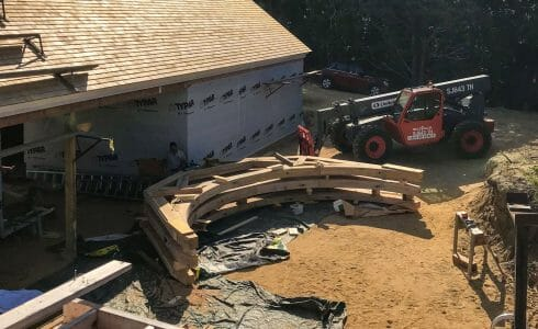 Preparing to lift the reclaimed oak hammer beam trusses at the Seven Gates Residence in Martha's Vineyard