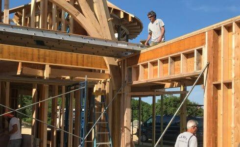 The reclaimed oak hammer beam trusses at the Seven Gates Residence in Martha's Vineyard