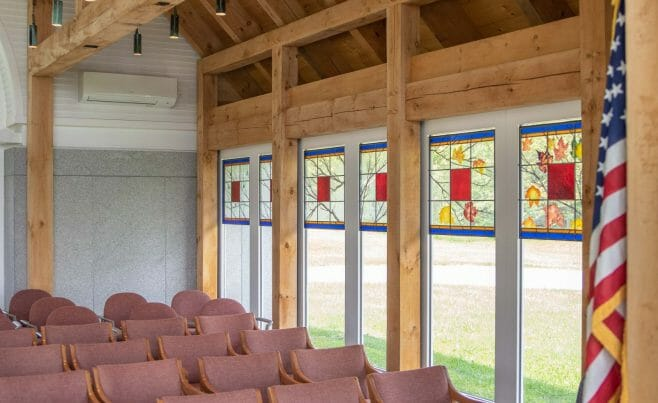 Stained Glass in the Interior of the Vermont Veterans Memorial Chapel. This church was made with Hemlock and Pine and features Girder Trusses.