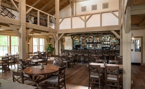 Interior of the Briar Barn Inn in Rowley, MA. The Monitor style barn features rough sawn Hemlock posts, beams, and trusses.