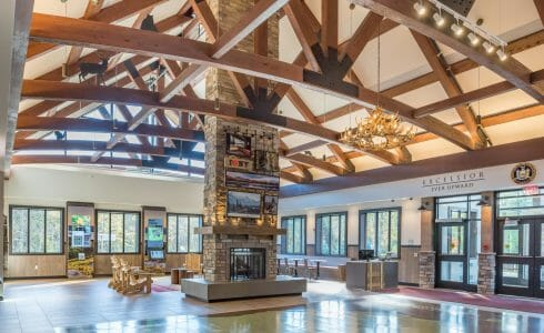 Interior of the Adirondack Welcome Center in Queensbury, NY featuring Douglas fir Glulam Heavy Timber Trusses with steel plates.