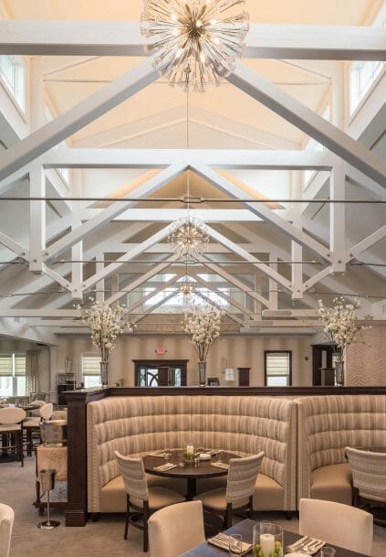 Modern, White heavy timber trusses with steel plates and tie bars in the Anya Restaurant in Thompson, CT.