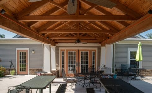 Heavy Timber Walkway with King Post Trusses in Doug fir, planed and chamfered with post bases with stone in Voorhees, NJ