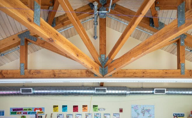 A classroom in the Centennial Senior Center that features Timber Trusses with steel plates