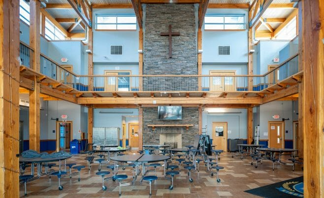 The Concord Christian Academy (previously the Centennial Senior Center) features cathedral ceilings and timber girder trusses.
