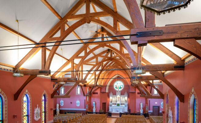 The completed interior of St. Michael's Church with arched trusses and steel tie rods