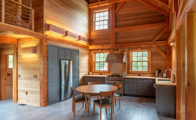 Interior of the Guest House on Martha's Vineyard that features Timber Posts and Beams, and Cedar cladding